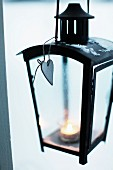 Lit tealight in black lantern
