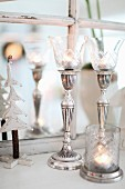 Elegant, silver candlesticks with glass shades and matching tealight holder