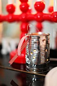 Tealight holder made from tin can and ribbon