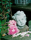 Cherub's head and peonies