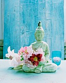 Buddha ornament with hollyhock and lilies
