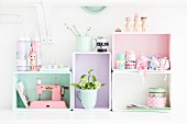 Kitchen shelving modules made from wooden crates painted in pastel shades