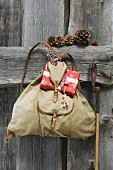 Traditional knapsack with Christmas arrangement next to old ski pole