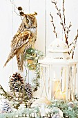 Woodland romanticism - candle lantern, stuffed eagle owl, mushroom ornaments and pie cones
