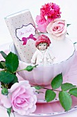 Chocolate, doll and roses in vintage bowl
