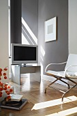 Television and armchair in a modern living room