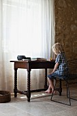 A boy sitting at a desk coloring