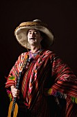 Man dressed as stereotypical Mexican with guitar