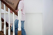 Carrying a box up the stairs