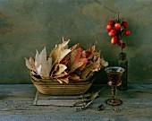 Autumnal, still-life arrangement of leaves & crab apples