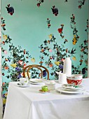 Dining area with spring atmosphere created by floral-patterned wall and floral coffee set