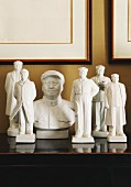 China figurines of Mao Zedong on wooden cabinet