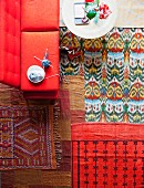 Colourful rugs in living room with coffee table and red sofa