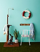 Accessories for garden and terrace: outdoor shower, hare ornament, Sansevieria, white metal chair, coat rack and lifebelt