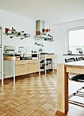Corner of wooden dining table and modern kitchen counter in minimalist kitchen