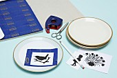 Instructions and craft materials for painting plates