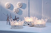 Festive tealight holders made from string of transparent hot-melt adhesive
