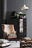 Modern vintage French effect with Toile de jouy; antique armchair in front of black-painted chest of drawers