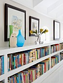 Vases on low bookcase in knee wall