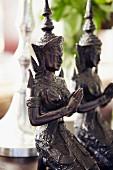 Oriental metal goddess figurines