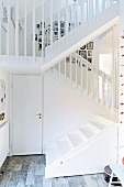 Staircase with white-painted balusters in open-plan stairwell