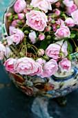 Ceramic vase of freshly-cut pink roses