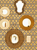 Collection of mirrors on retro wallpaper with black and yellow graphic pattern