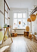 Lampshades made from wooden scales in rustic showroom of lamp-maker with pristine wooden floor