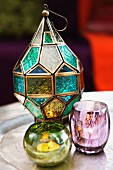 Oriental-style candle lanterns made from glass of various colours