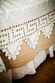 White lace bedspread with trim