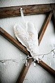 Heart-shaped sachet fixed to wooden frame