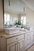 Elegant, American-style washstand with twin sinks and large mirror