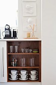 Crockery in open-fronted kitchen base unit