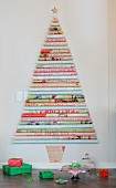 Stylised Christmas tree made from various rolls of patterned wall on wall