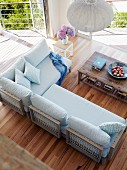 View down onto designer sofa and rustic wooden coffee table