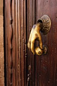 Detail of door with hand-shaped handle; San Miguel de Allende; Guanajuato; Mexico