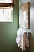 Detail of white towel on rail in bathroom
