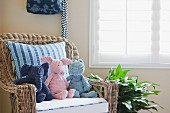 Soft toys on wicker armchair; California; USA