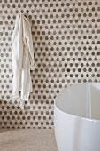 Contemporary bathroom with bathrobe and bathtub; Irvine; California; USA