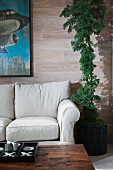 Cropped couch, house plant and painting in living room; Irvine; California; USA