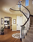 Brown and white balustrade on staircase in contemporary house