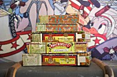 Cigar boxes stacked on old trunk against comic-style backdrop