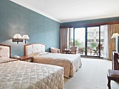 Bedroom with balcony in hotel