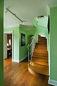 Wood floor hallway with green walls along stairs; West Palm Beach; USA