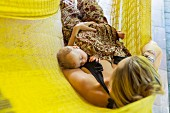 Mother and baby relaxing in hammock