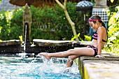 Girl splashing in swimming pool