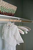 Close-up of child's clothing hanging in wardrobe