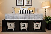 Scatter cushions on bed with storage baskets