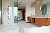 Contemporary bathroom with glass shower; Newport Beach; California; USA