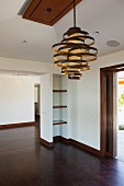 Creative pedant lamp in empty foyer; Newport Beach; California; USA